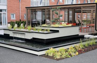 Trest entreprenør har bygget plantekasse i Leca blokker, foss, Pergola i MøreRoyal Talgø og planting i Catosenteret, Son, Oslo