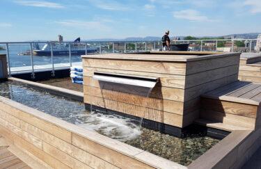 Trest Entreprenør bygge foss på takterrasse av termoask terrassebord i oslo